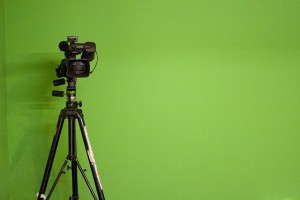video camera against green background